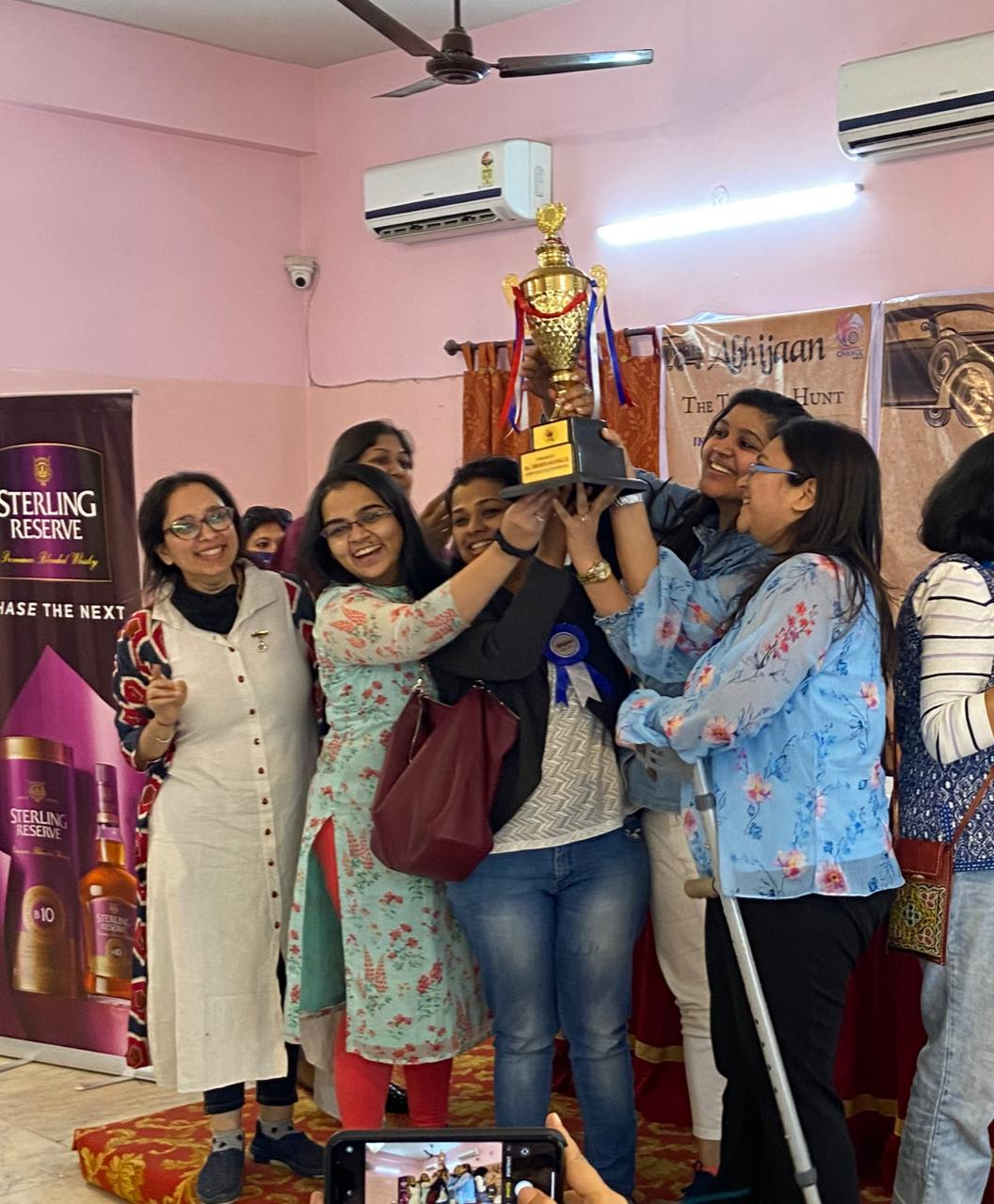 Members of IWC Kolkata New Gen with the winner's cup